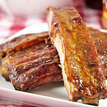 Cajun-Spiced Smoked Spare Ribs Recipe from ItsYummi.com - This recipe has an option for smoking the ribs with a smoker or baking them in an oven. They're dry rubbed first and then finished off with a tangy Louisiana style barbecue sauce.