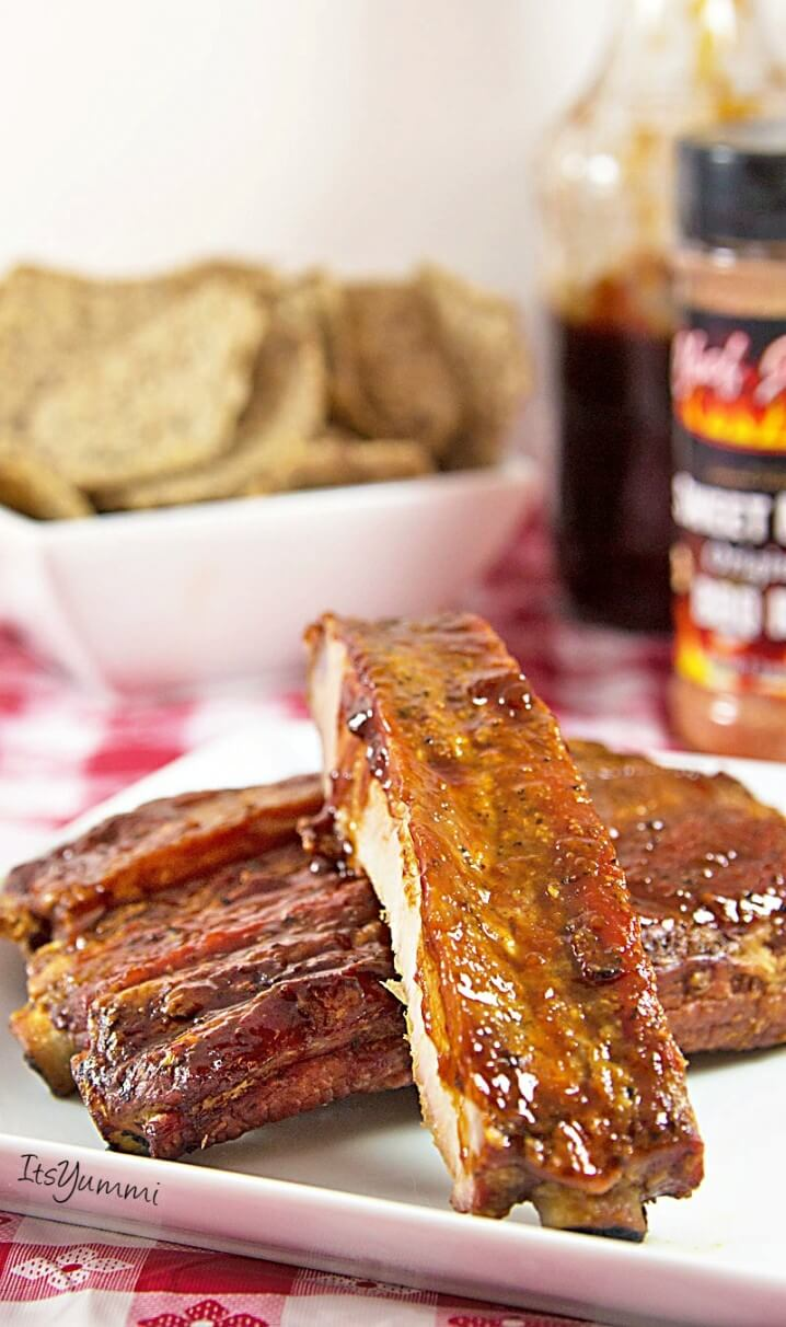 smoked ribs mopped with Louisiana-style BBQ sauce
