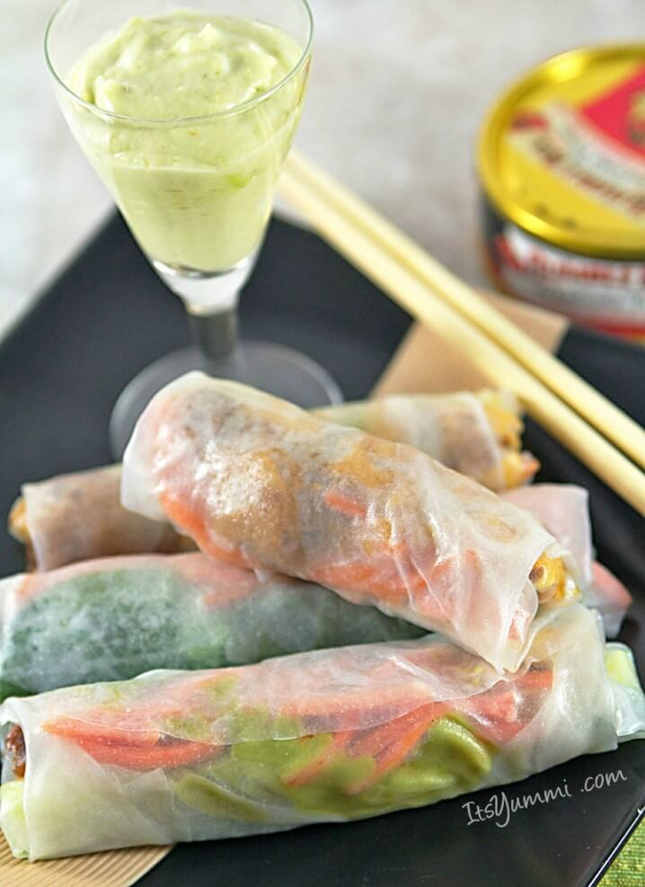 Sundried Tomato Tuna Spring Rolls on a plate with avocado crema dipping sauce