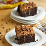 Extreme Chocolate Poke Cake - This dessert has 5 different layers of chocolate in it! Chocolate cake, chocolate pudding, chocolate ganache, chocolate whipped cream, and mini chocolate chips. It's all topped off with a drizzle of caramel, making this an extreme chocolate lover's dessert! Recipe on ItsYummi.com