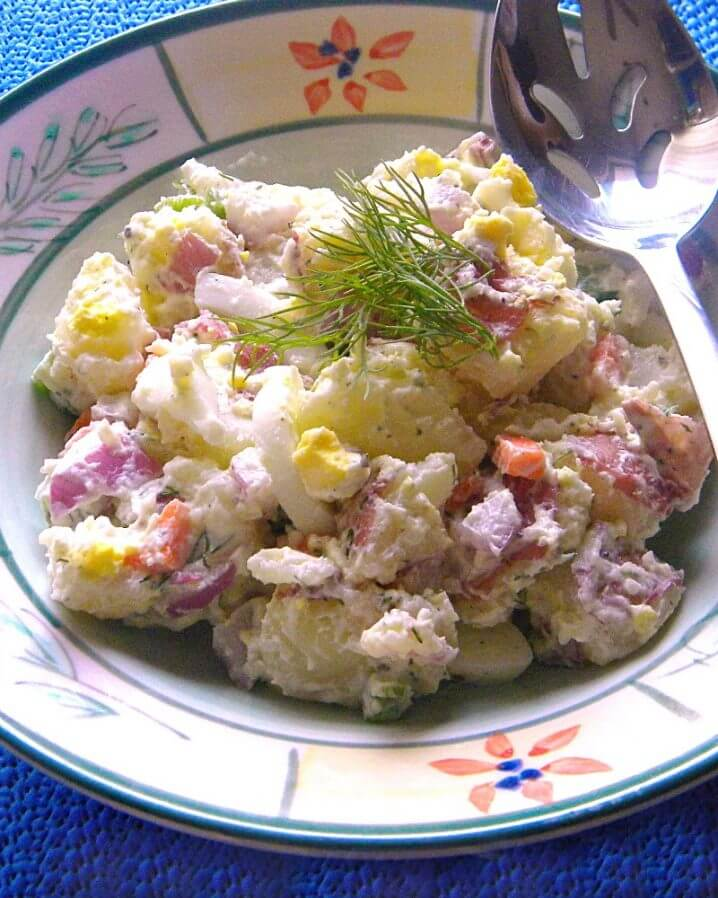 close up image of a bowl of farmer's market potato salad with eggs