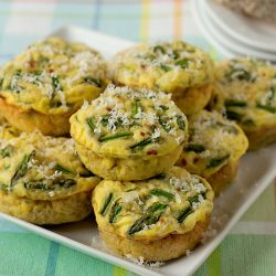 crustless quiche muffins with quinoa and asparagus on a white plate