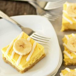 plated dessert - banana cheesecake bars with white chocolate drizzle
