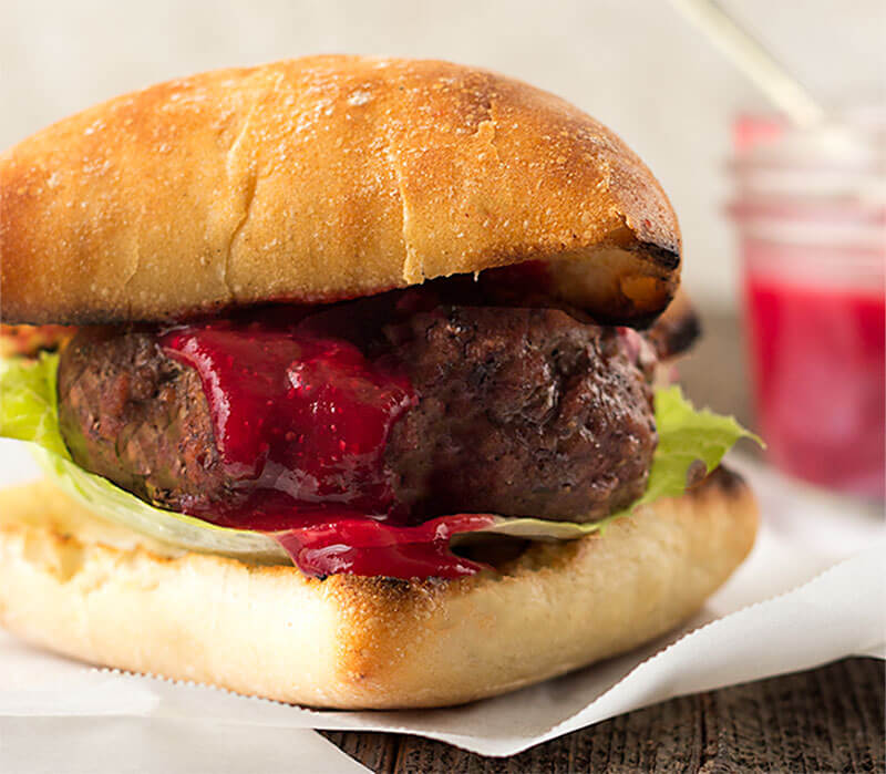 Gorgonzola Stuffed Burgers - Sirloin burger stuffed with gorgonzola cheese, topped with homemade cranberry mustard