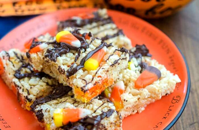 Halloween Chocolate Rice Krispie Treats on a Halloween themed plate