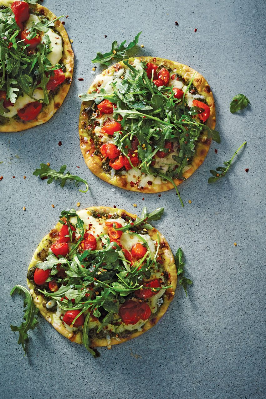 Pesto Flatbread Pizza with Mozzarella, Tomato, and Arugula is a delicious clean eating food recipe, created by Chef Sam Talbot. Get the healthy pizza recipe and read our review of his cookbook, 100% Real; 100 Insanely Good Recipes for Clean Food Made Fresh (Copyright © 2017 Oxmoor House).