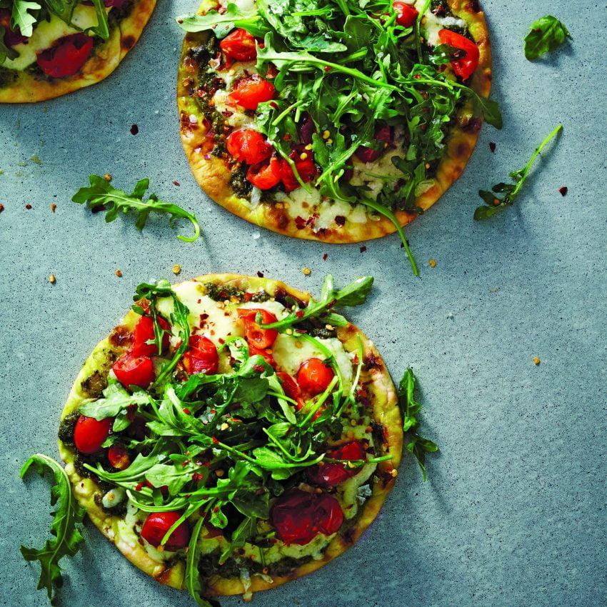 Pesto Flatbread Pizza with Tomato, Arugula, and Mozzarella Cheese