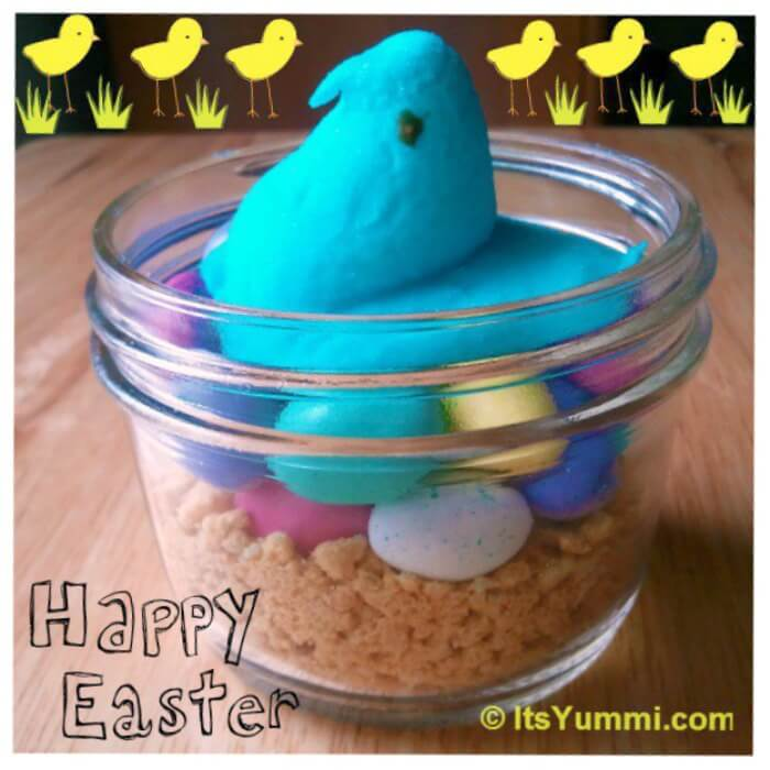 "marshmallow peep mama to be sitting on a ""nest"" of malted milk ball eggs in a mason jar"