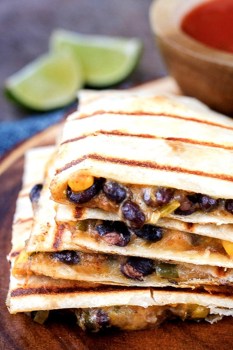 stack of Southwest vegetarian quesadillas filled with spicy corn and black bean mixture