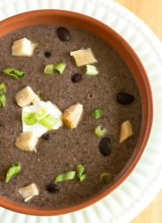 bowl of spicy chicken soup with black beans