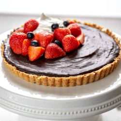 chocolate tart with fresh strawberries and blueberries
