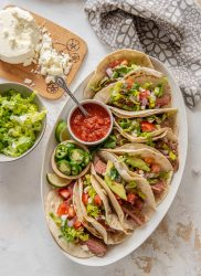 pan seared steak tacos on white platter