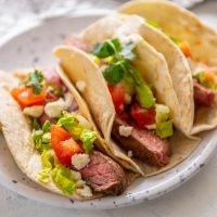 3 steak tacos with toppings