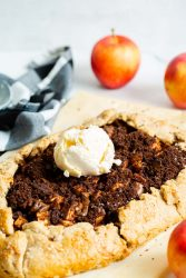 A finished apple galette is served with vanilla ice cream.